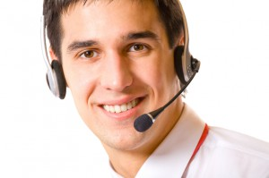 Portrait of happy support operator in headset, isolated
